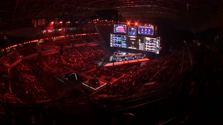 forma : MOSCOW, RUSSIA - 14th SEPTEMBER 2019: esports gaming event. Main stage with a big screen showing the match game moments. Arena lit with a blue color.