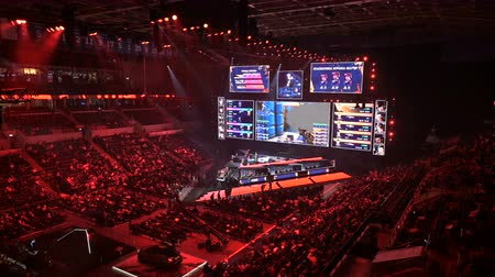 konzol : MOSCOW, RUSSIA - 14th SEPTEMBER 2019: esports Counter-Strike: Global Offensive event. Main stage, lightning, illumination, big screen with game moments from overlooking spot at the top.