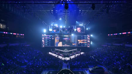 иероглиф : MOSCOW, RUSSIA - 14th SEPTEMBER 2019: esports Counter-Strike: Global Offensive event. Main stage venue, players booths, big screen with a game moments on it.