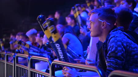replication : MOSCOW, RUSSIA - 14th SEPTEMBER 2019: esports Counter-Strike: Global Offensive event. Fans on a tribunes cheering and supporting for thier favorite teams.