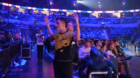 competitivo : MOSCOW, RUSSIA - 14th SEPTEMBER 2019: esports Counter-Strike: Global Offensive event. Dedicated enthusiastic fan at arena cheering and worried about his favorite team.