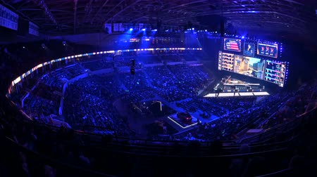 иероглиф : MOSCOW, RUSSIA - 14th SEPTEMBER 2019: esports Counter-Strike: Global Offensive event. Main stage with a big screen showing the matchs game moments. Arena lit with a blue color.