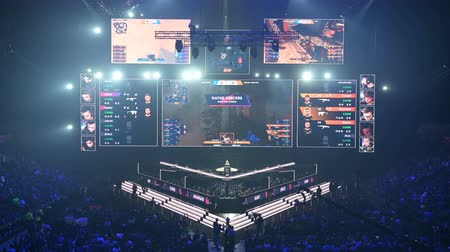 MOSCOW, RUSSIA - 14th SEPTEMBER 2019: esports gaming event. Big crowd on a stadium. Main stage venue, players booths, big screens with a game moments on it. Big crowd on a stadium. Stok Video