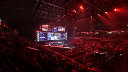 flama : MOSCOW, RUSSIA - 14th SEPTEMBER 2019: esports Counter-Strike: Global Offensive event. Main stage, lightning, illumination, big screen with game moments from overlooking spot at the top.