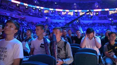 torcendo : MOSCOW, RUSSIA - 14th SEPTEMBER 2019: esports Counter-Strike: Global Offensive event. Fans on a tribunes cheering and supporting for thier favorite teams.