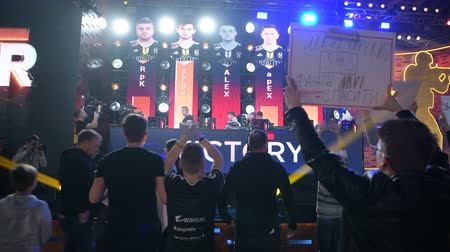 MOSCOW - 23th DECEMBER 2019: esports Counter-Strike: Global Offensive event. Fans supporting and cheering for their team staying close to the stage. Players just finished match. Stok Video