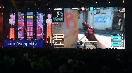 MOSCOW - 23th DECEMBER 2019: esports event. Big crowd on a stadium. Big venue, players on a stage, big screens with a game moments on it. Big crowd on a stadium. Stok Video