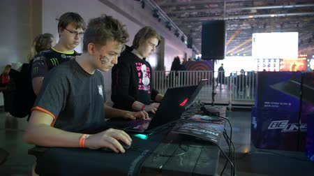 MOSCOW - 23th DECEMBER 2019: esports event. Gamers playing the Counter Strike game versus each other on a modern laptops at ASUS ROG sponsor zone.