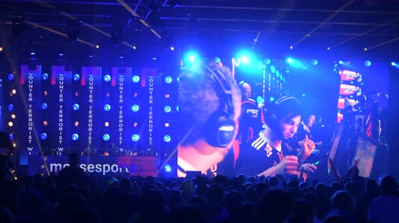 MOSCOW - 23th DECEMBER 2019: esports event. Big crowd on a stadium. Big venue, players on a stage, big screens with a game moments on it. Big crowd on a stadium. Dostupné videozáznamy