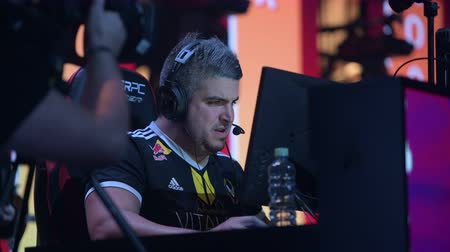 стример : MOSCOW - DECEMBER 23 2019: esports professional gaming event. Member of a french team Vitality player Cedric RpK Guipouy on a stage during tournament game.