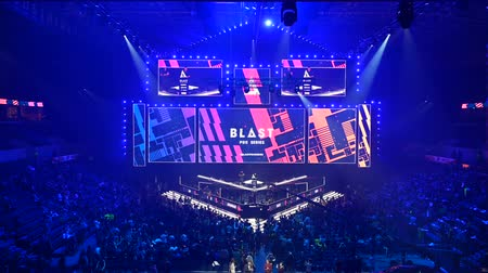 MOSCOW, RUSSIA - 14th SEPTEMBER 2019: esports Counter-Strike: Global Offensive event. Main stage, lighting, illumination, big screen on the opening ceremony. Stage lit with a blue color turning to red.