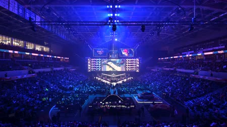 MOSCOW, RUSSIA - 14th SEPTEMBER 2019: esports gaming event. Main stage of a big esports arena. Spotlight on a main prize of the competition - big cup. Tournament starts with those lights.