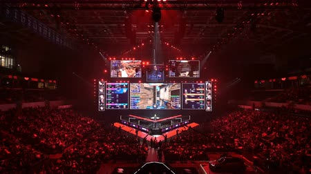 MOSCOW, RUSSIA - 14th SEPTEMBER 2019: esports Counter-Strike: Global Offensive event. Main stages screen with a game moments and players booth at the center of the frame. Stok Video