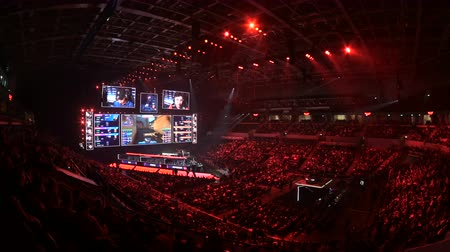 MOSCOW, RUSSIA - 14th SEPTEMBER 2019: esports gaming event. Big arena, lighting, illumination, giant screens on a stage. Stage lit with a blue color turning to red.