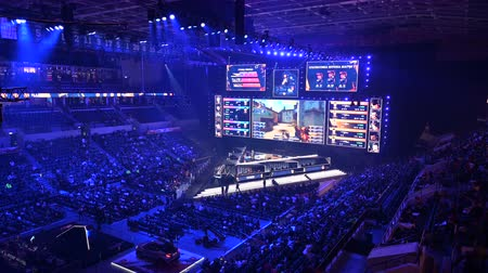 MOSCOW, RUSSIA - 14th SEPTEMBER 2019: esports gaming event. Big venue, lighting, illumination, giant screens on a stage. Stage lit with a blue color. Arena full of young gamers. Stok Video