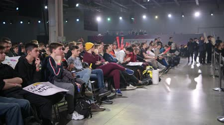 counter strike : MOSCOW - DECEMBER 23 2019: esports Counter-Strike: Global Offensive event. Main venue, lots of rows of chairs with a fans watching the game and supporting favorite teams. Big crowd at arena.