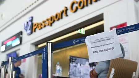 щит : Phuket, Thailand - March 04 2020. Paper with announcement of temperature control zone, monitor of thermal scanner camera to check people entering an airport during Coronavirus, Covid 19 outbreak in Thailand.