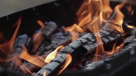yaymak : Slow motion fireplace close up for bbq, nature yellow fire. Burning wood in the fireplace close up