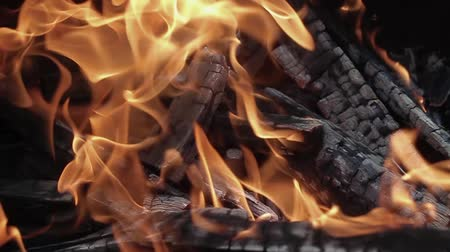 yaymak : Slow motion fireplace closeup for bbq, nature yellow fire. Burning wood in the fireplace close