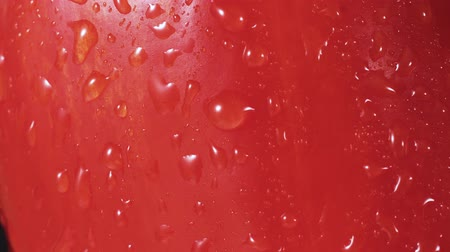 pimentas : Red bell pepper spray close up, drops of water going down