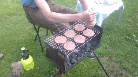 briquettes : Man preparing barbecue on the grill