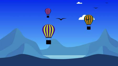 Mountain landscape with flying air balloons. The background flies birds and clouds in the blue sky.