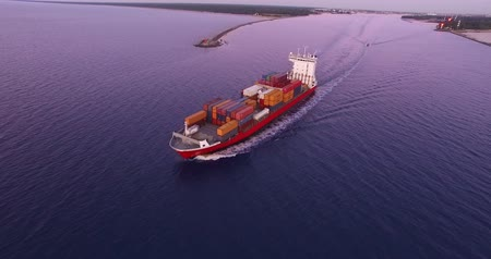 damarlar : 4K - To follow the cargo ship. Aerial view Stok Video