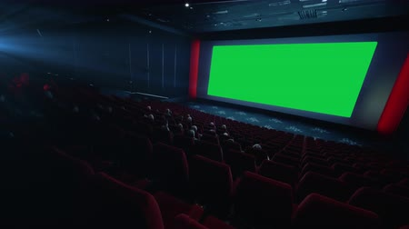 premiere : 4K - People watching movie in cinema theater. green screen. chroma key