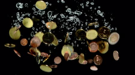 cent : HD - Euro coins falling into water. Slow motion