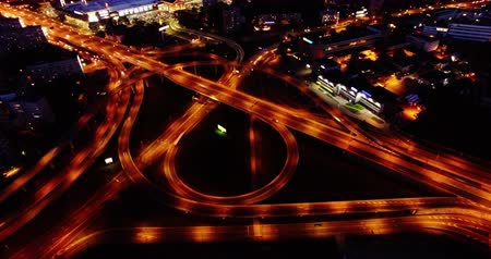 4K - Night city traffic. Aerial view timelapse