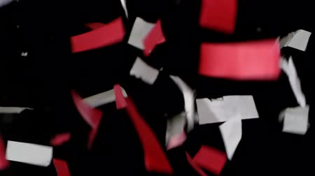 HD - Confetti. Red and white pieces slowly fall down Stok Video