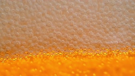 Октоберфест : HD - Beer foam close-up. Slow motion