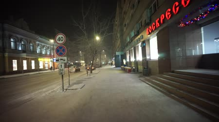 Walking in the night city in the extreme frost