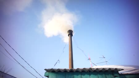 Smoking chimney in the winter