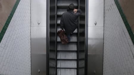 エスカレーター : Top down view of moving up escalator in metro. Man going up to escalator