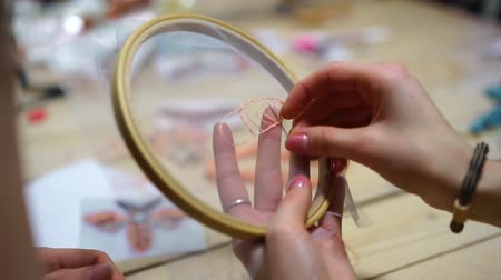 bordado : handmade embroidery, girls embroidery on the Hoop with colored thread Stock Footage