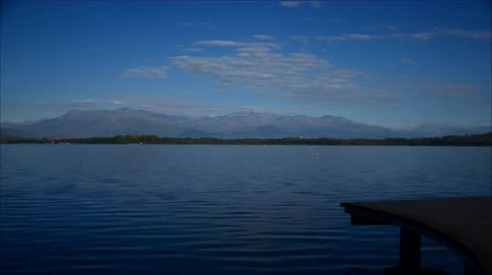 aswan : Viverone (Torino), Italy - March 21, 2011: Lake Viverone in spring, with pre-Alps and Alps. Stock Footage