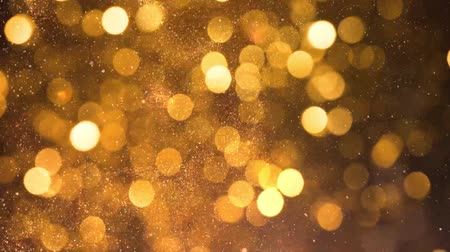 fénylik : Golden glitter particles background Stock mozgókép