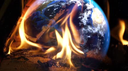 caution sign : Earth on fire.Environmental disasters social outreach