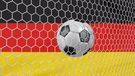 Ball in the net Soccer gate on the background of the Germany flag. 3d rendering.