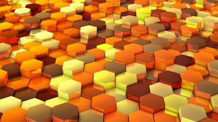 A network of hexagons yellow hue, which change height. 3D render.
