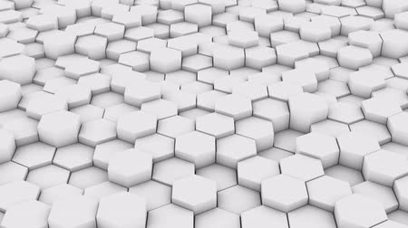 A network of hexagons, which change height. 3D render.
