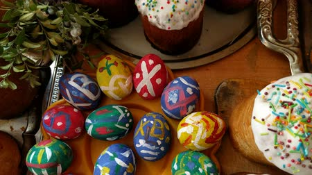 Easter cakes and painted eggs for the Easter holiday closeup. Stock Footage