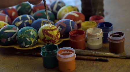 Painting Easter eggs with paints and a brush