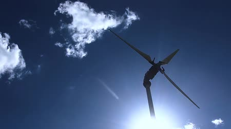 romsvetnik : The sun shines with backlight on the wind turbine. Renewable energy. Green technology.