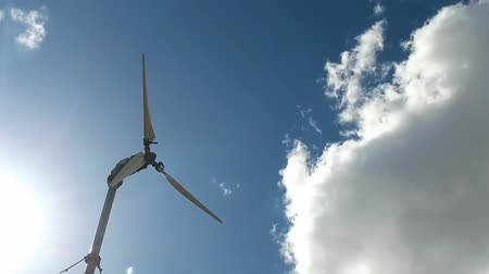 romsvetnik : Wind turbine in sunlight. Sky with a huge cloud on the background. Slow motion.