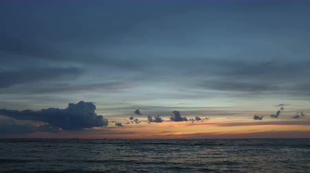 Beautiful sky over the sea during sunset. Cargo ships on the horizon.