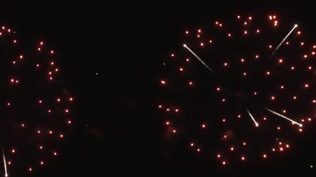 consecutivo : Fireworks Flashing in the Night Sky. Slow Motion.