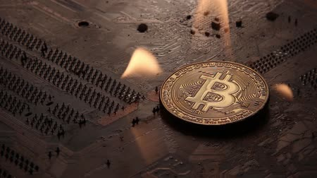 The Golden Bitcoin burns with fire on the tracks of the electronic board.