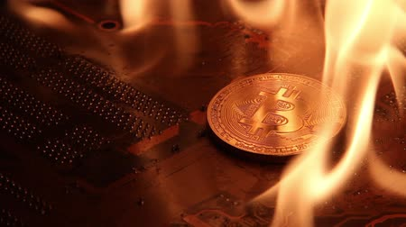 Coin physical Gold bit-coin in a violent fire.